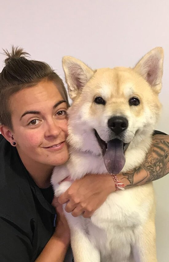 Sam with a happy groomed dog